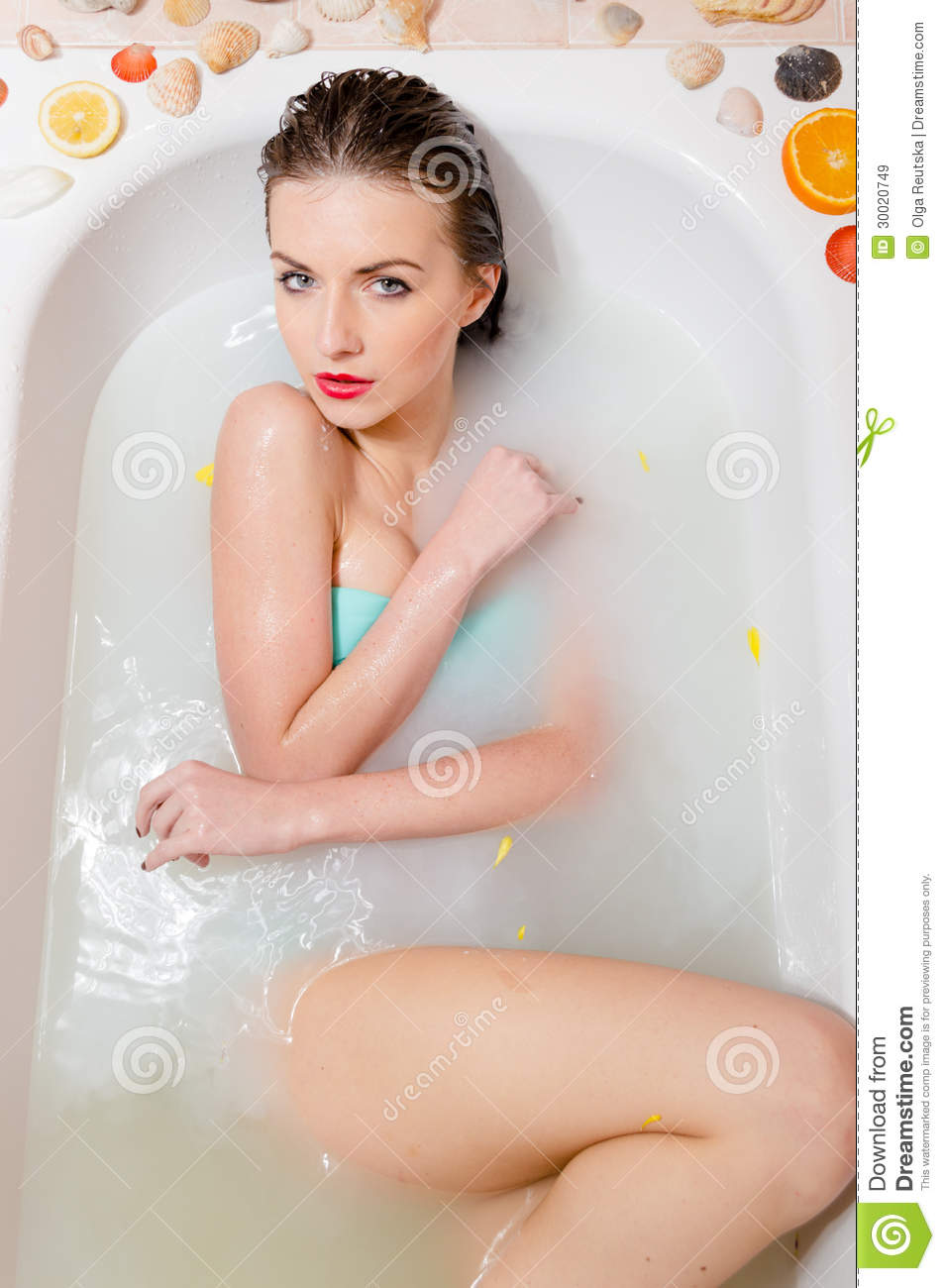 Pretty Woman Relaxing In Milk Bath With Flowers Royalty Free Stock.