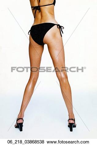 Pictures of woman portrait body black swim costume bathing suit.