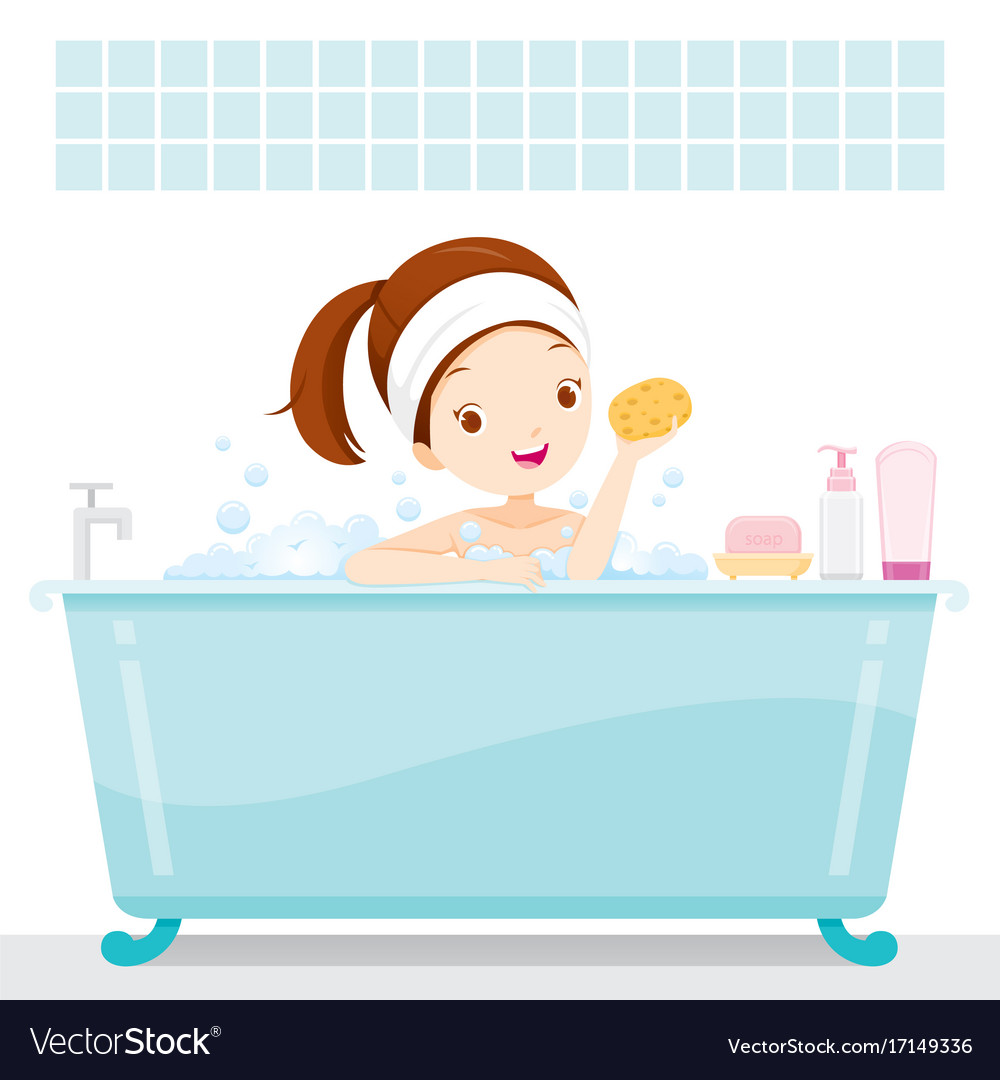 Cute girl bathing in bathtub in bathroom.