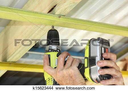 Stock Photo of putting up ceiling battens k15623444.