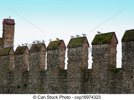 Clip Art of Castle battlements with many seagulls standing over.