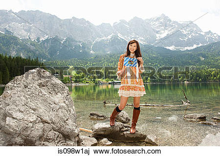 Stock Photo of Woman with Bavarian flag, Lake Eibsee and Mount.