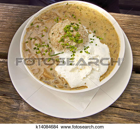 Stock Photo of Bavarian food, bread dumpling with mushroom sauce.
