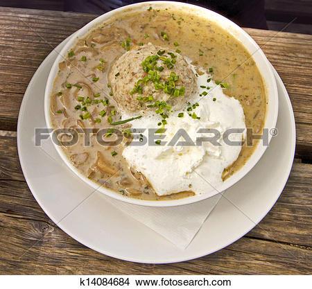 Stock Photo of Bavarian food, bread dumpling with mushroom sauce.