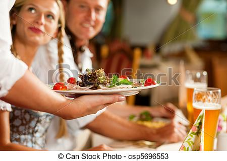 Stock Photos of Waitress serving an Bavarian Restaurant.