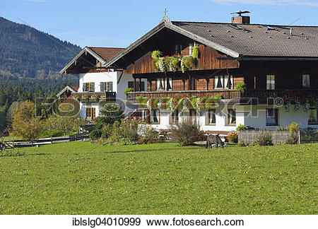 """Stock Photograph of """"Farmhouse in the Bavarian style with wooden."""