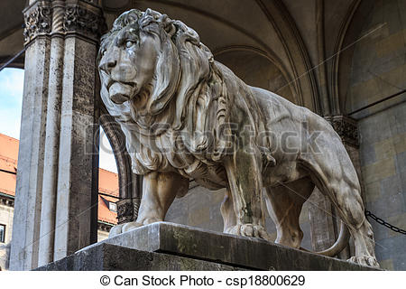 Stock Photo of Munich, Bavarian Lion Statue in front of.