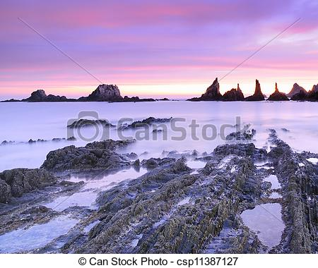 Clip Art of Sunrise on the Bay of Biscay..