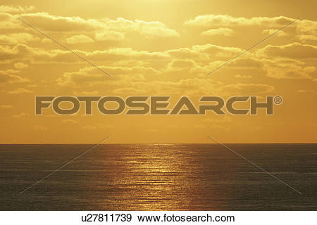 Stock Photograph of Sunset taken from the ferry, which is used by.