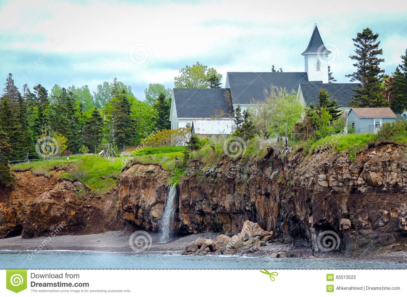 Waterfalls Behind A Church. Edge Of Canada At Margaretsville, Bay.
