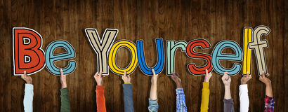 Group Of Hands Holding Word Be Yourself Stock Photo.