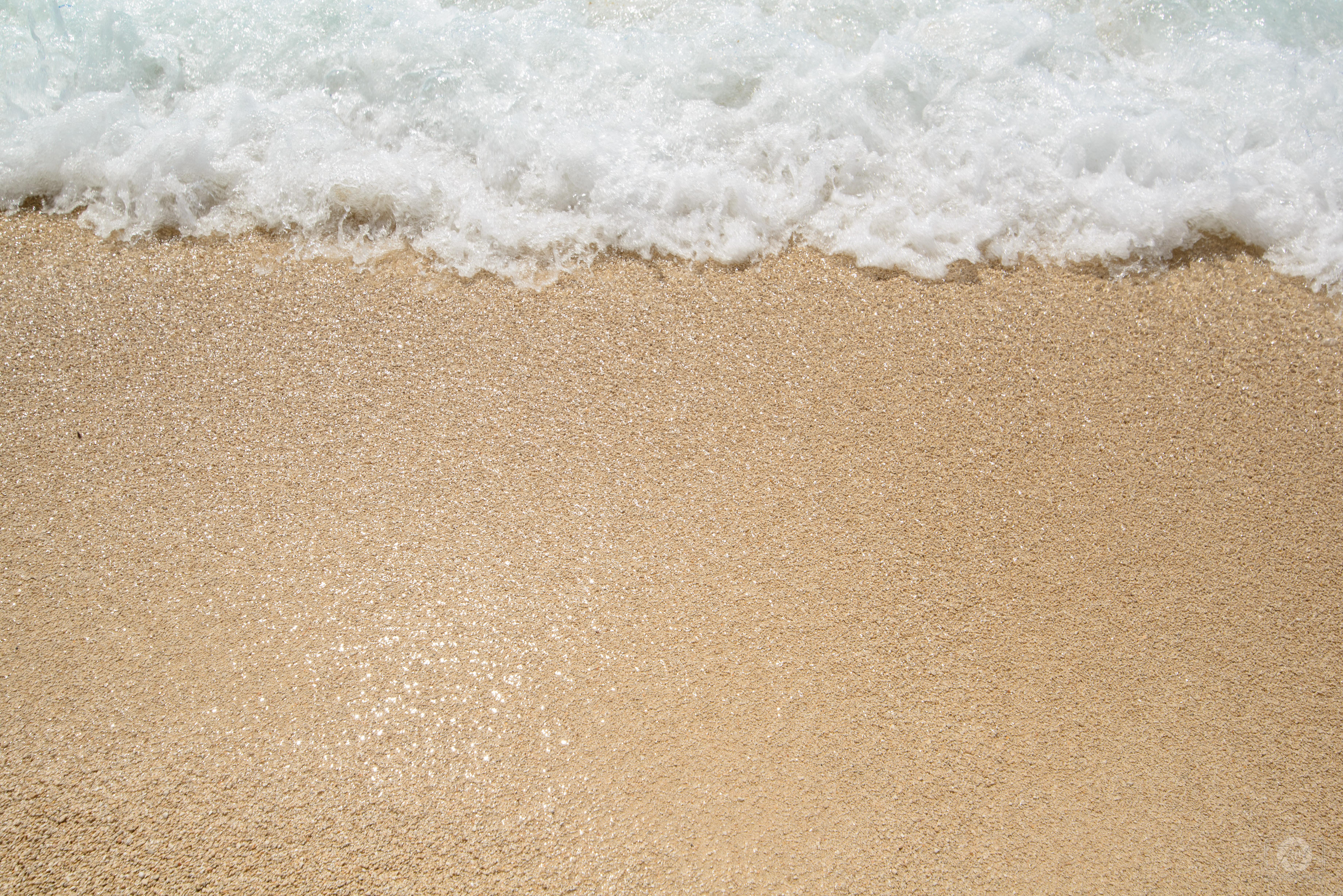 Sea Wave on Sand Texture.
