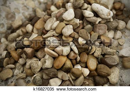 Stock Image of Small beach stones and sand river k16827035.