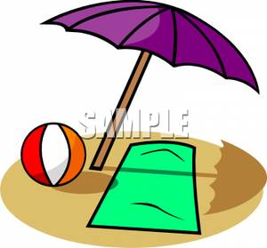 Beach Towel And Ball Underneath An Umbrella.