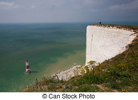 Stock Image of Beachy Head Lighthouse with chalk cliffs near the.
