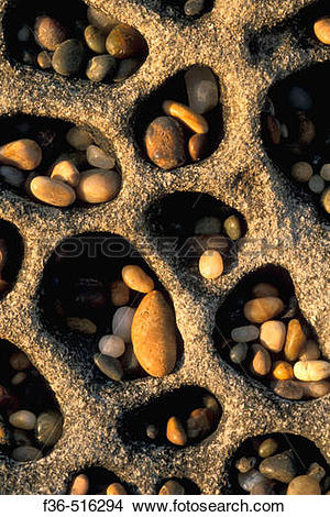 Stock Photo of Small smooth stone rock pebbles caught in wind.