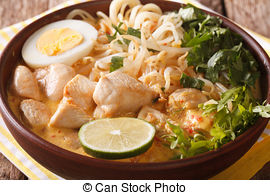 Stock Image of Asian Laksa soup with chicken, egg, noodles.