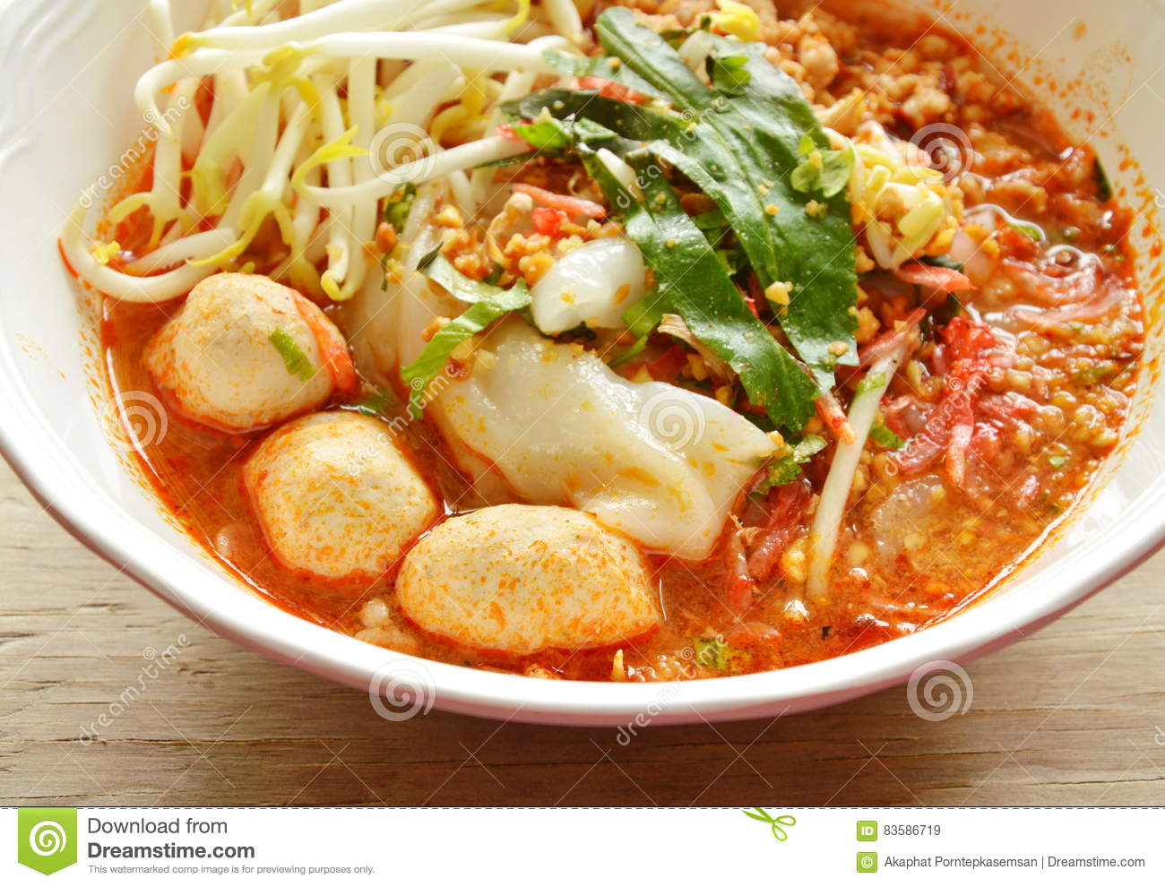 Rice Noodle With Pork Ball In Tom Yum Spicy Soup Topping Raw Bean.