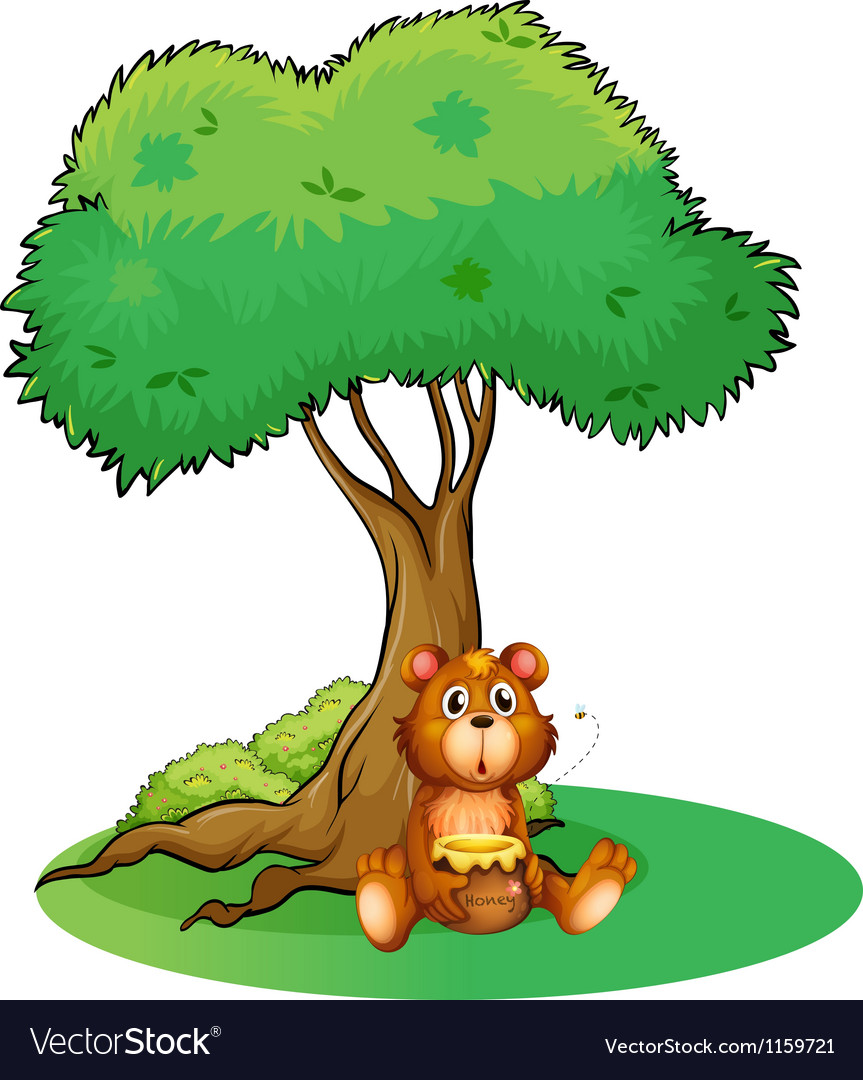 A bear sitting under a big tree.