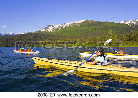 Stock Photography of Family Sea Kayaking In Together On Bear Lake.