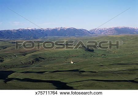 Stock Photo of St Olaf church and Beartooth Mountains, Montana.