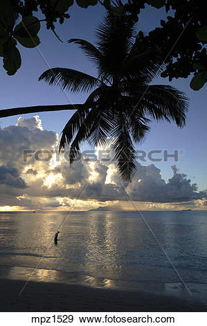 Stock Photograph of Sunset at Beau Vallon Beach, Mahe Island.
