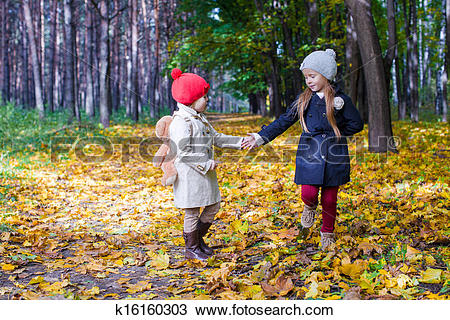 Stock Photo of Two beautiful adorable girls walking in the fall.