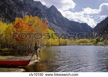 Stock Photography of Lisa FLY FISHES on GRANTS LAKE on a beautiful.