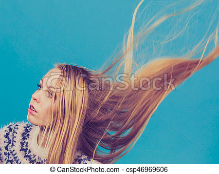 Crazy blonde woman with windblown blonde hair.