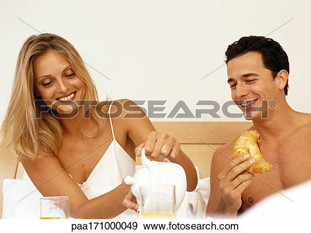 Stock Photograph of Couple having breakfast in bed, head and.