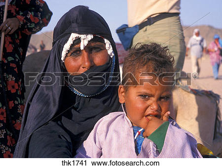 Stock Photography of Covered Bedouin woman with child, Egypt.
