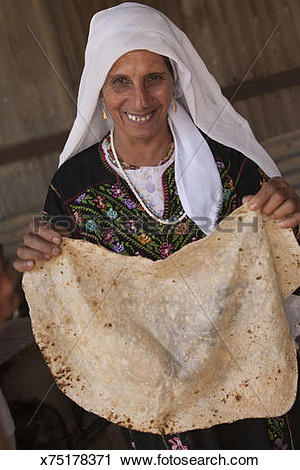 Stock Photography of Bedouin woman with freshly.