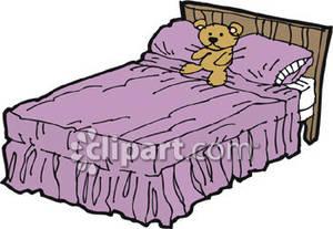 Teddy Bear on a Bed.