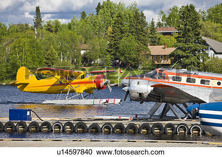 Stock Photography of Norseman aircraft arriving alongside a Beech.