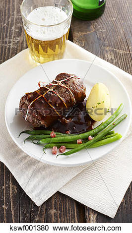 Stock Photography of Beef roulade with gree beand and boiled.