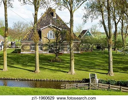 Stock Photograph of old farm at polder the Beemster in the.