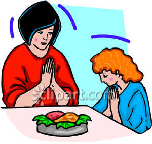 a_woman_and_a_girl_praying_before_a_meal_royalty_free_080804.