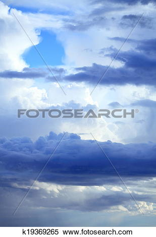 Stock Image of Deep blue sky with storm clouds before rain.