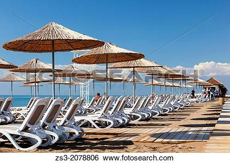 Stock Images of Parasols and sunbeds at the beach, Belek, Antalya.