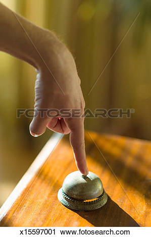 Stock Photography of Finger pressing hotel bell x15597001.