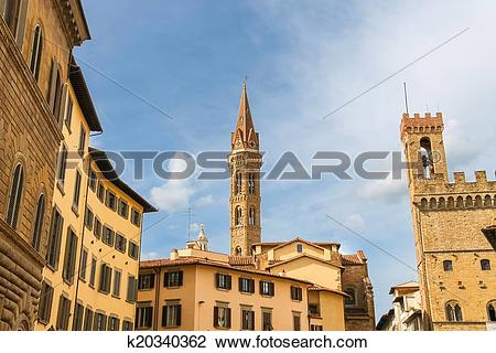 Stock Photo of Bell tower of Palazzo del Bargello and church spire.
