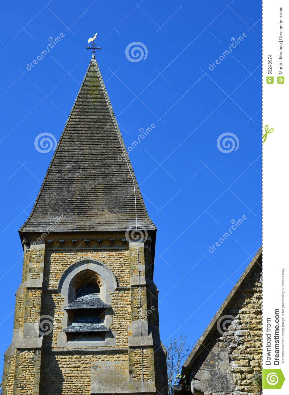 Bell Tower And Spire On A English Church Stock Photo.