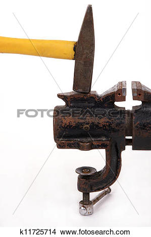 Stock Photo of Rusty old bench vise and a hammer on a white.