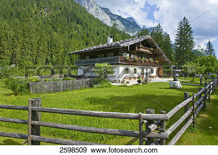 Stock Photograph of Farmhouse and fence in field, Hintersee.