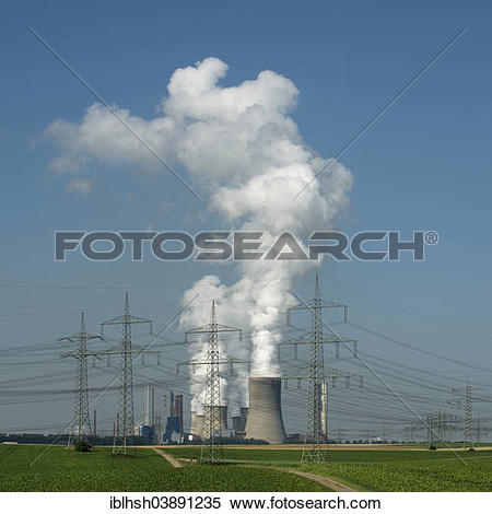 """Stock Image of """"Transmission lines in front of a power plant of."""
