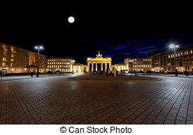 Stock Image of berlin night siegesseule street moon.