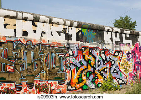 Stock Photo of Graffiti on East Side Gallery of Berlin Wall.