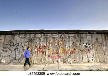 Stock Photograph of Germany, Berlin, East Side Gallery. A man.