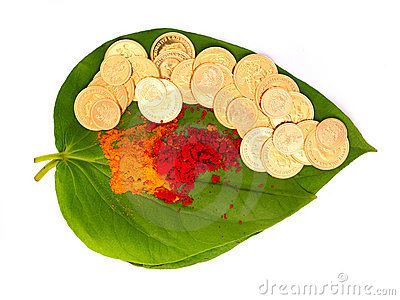 Gold Coins On A Betel Leaf Royalty Free Stock Images.