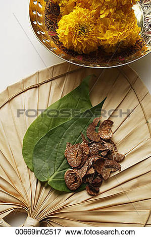 Picture of betel nut and leaves with chrysanthemums top view.